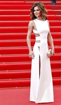 Cheryl Cole em vestido que mostra tudo