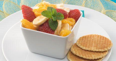 Taças de frutos com espumante
