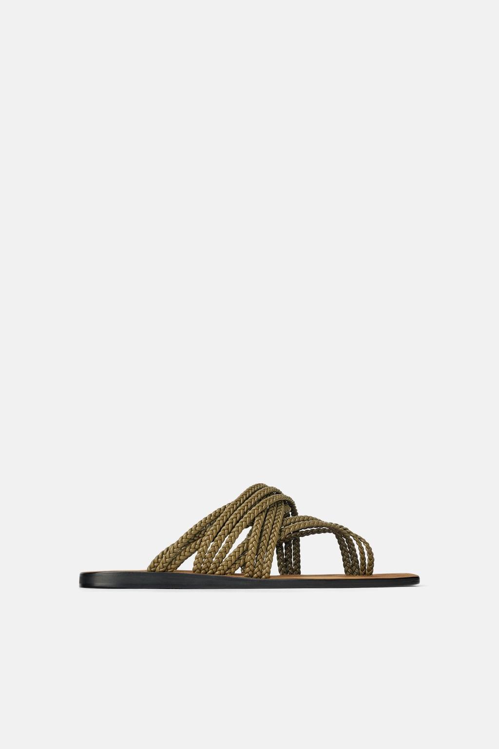 Sandália rasa trançada com tiras (29,99 euros, antes 39,95 euros).jpg