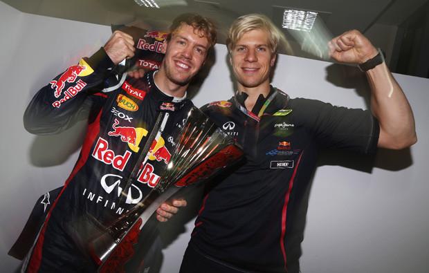 Sebastian Vettel com o seu treinador, Heikki Huovinen.jpg
