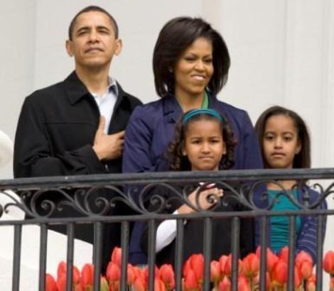 Barack e Michelle Obama com as filhas, Malia e Sasha