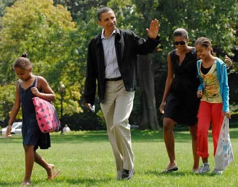 Barack e Michelle Obama com as filhas, Sasha e Malia