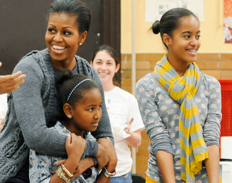 Michelle Obama com as filhas, Sasha e Malia